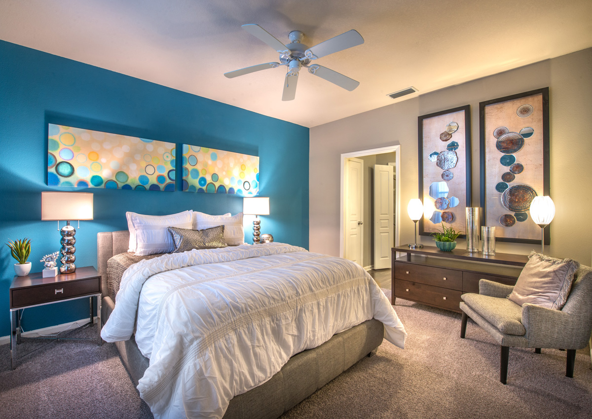 bedroom-with-ceiling-fan-and-carpet